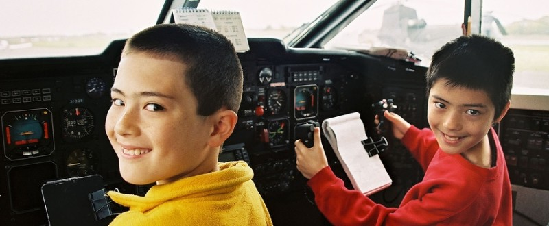 Boys in cockpit of airliner