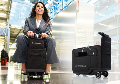 Woman on motorized, ride-able carry-on bag