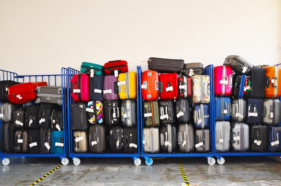 stack of lost luggage