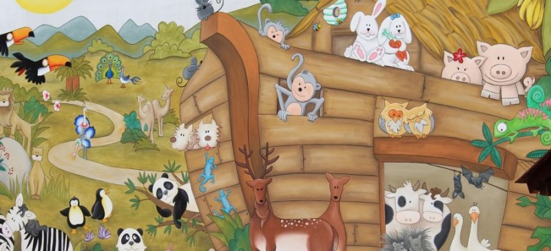 Happy animals crowding onto Noah's Ark.