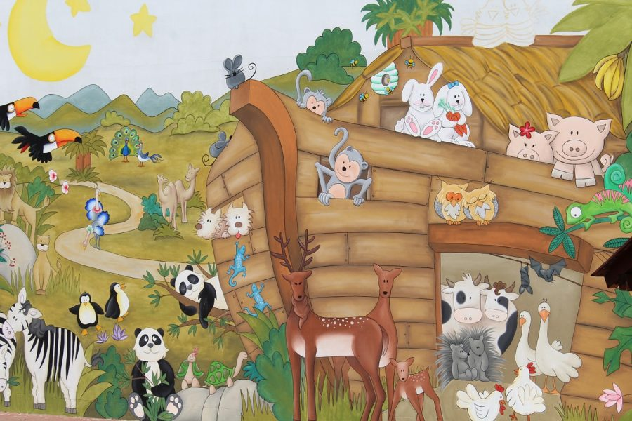 Happy animals crowding onto Noah's Ark.
