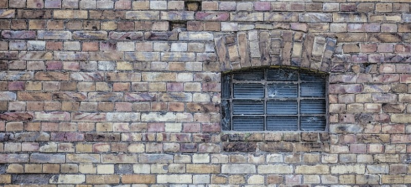 brick wall with barred window