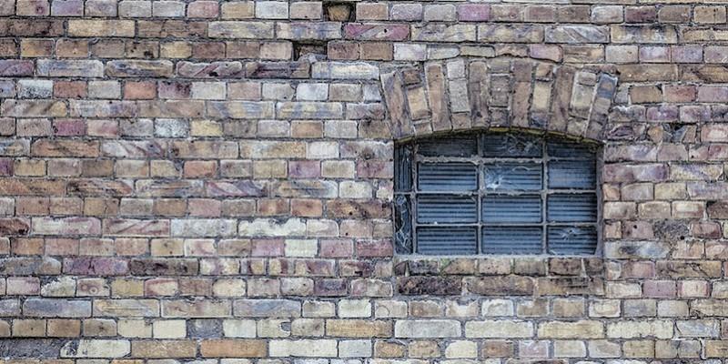 brick wall with barred window